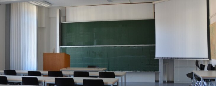 lecture room with a board